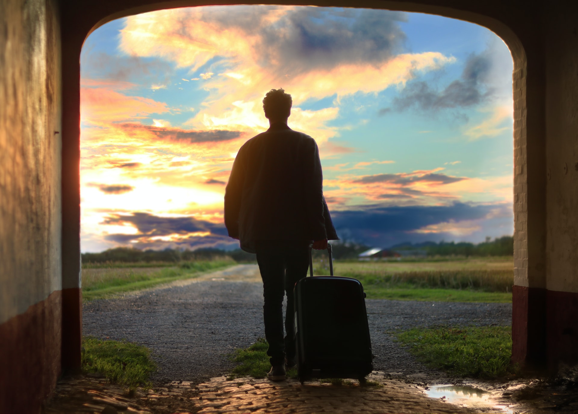 Leaving for a hero's journey with suitcase in tow